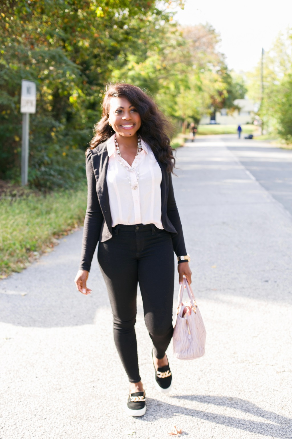 Thelma Okoro walking on the street