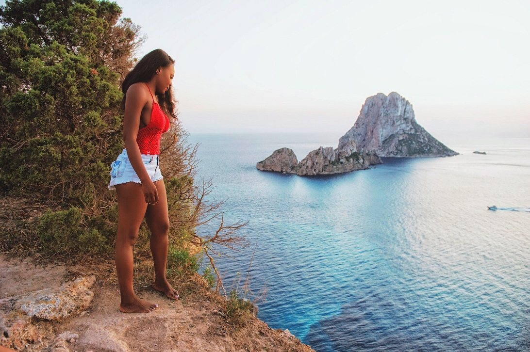 Thelma Okoro Standing by the cliff es vedra, es vedra sunset